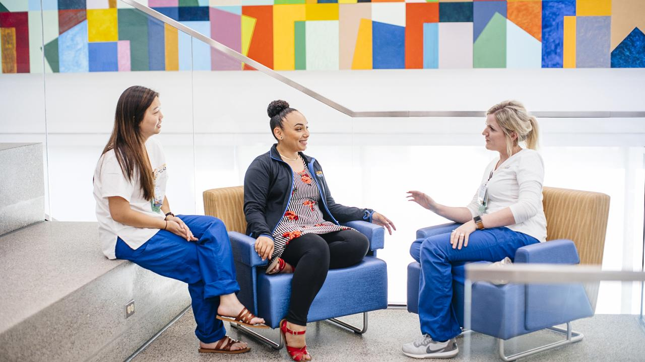 three uc davis nurses talking with one another
