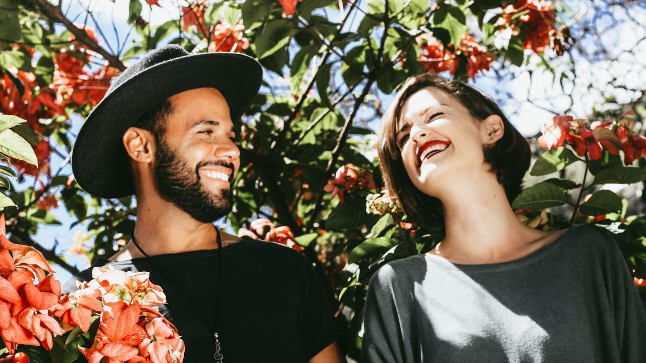 young man and woman smiling