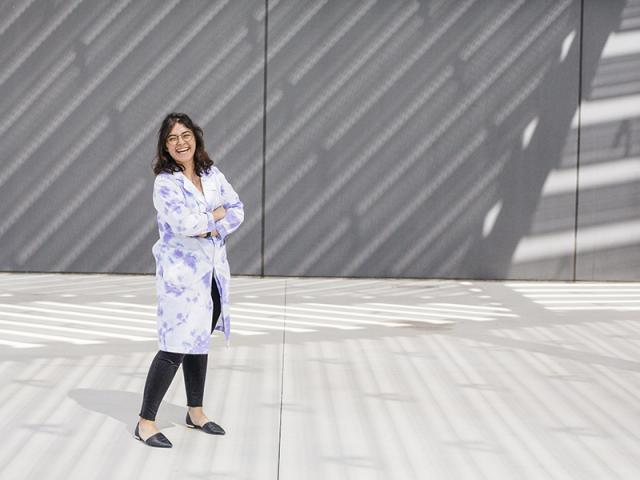 woman smiling outside of the uc davis shrem museum